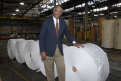 Edgar Smith with Paper Roll Stock in a  Paper Mill